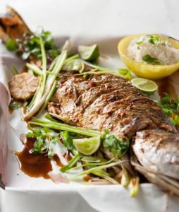 Whole baked fish in ginger, soy and lime