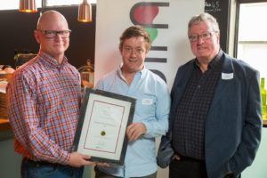 Editor Christian Eedes and Garry King of Tonnellerie Saint Martin present HRV's Emul Ross with a ratings certificate for his 2016 vintage.